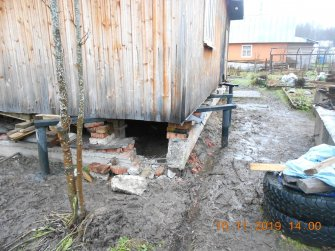 Подъем дома на винтовые сваи и укрепление фундамента швеллером - фото 5